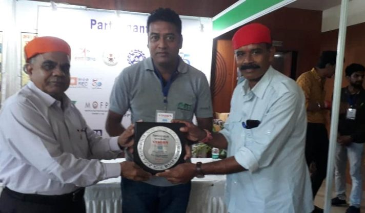 Assistant Manager (M) holding the award for Best stall in awareness at Vision Rajasthan, 2019